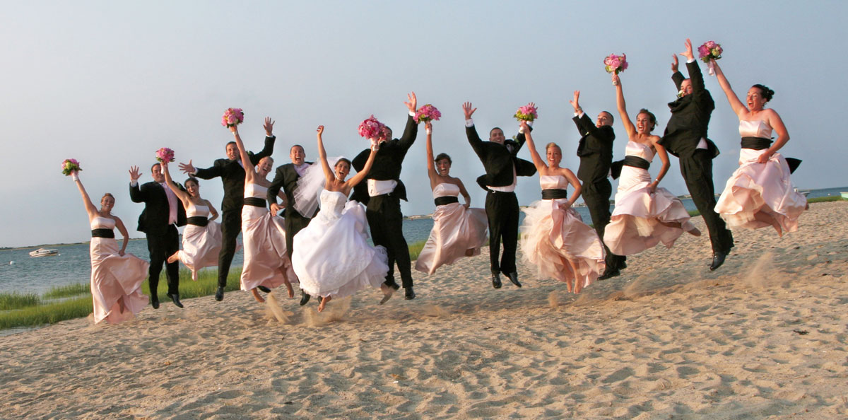 Cheers! Bridal Party Celebrating on the Beach